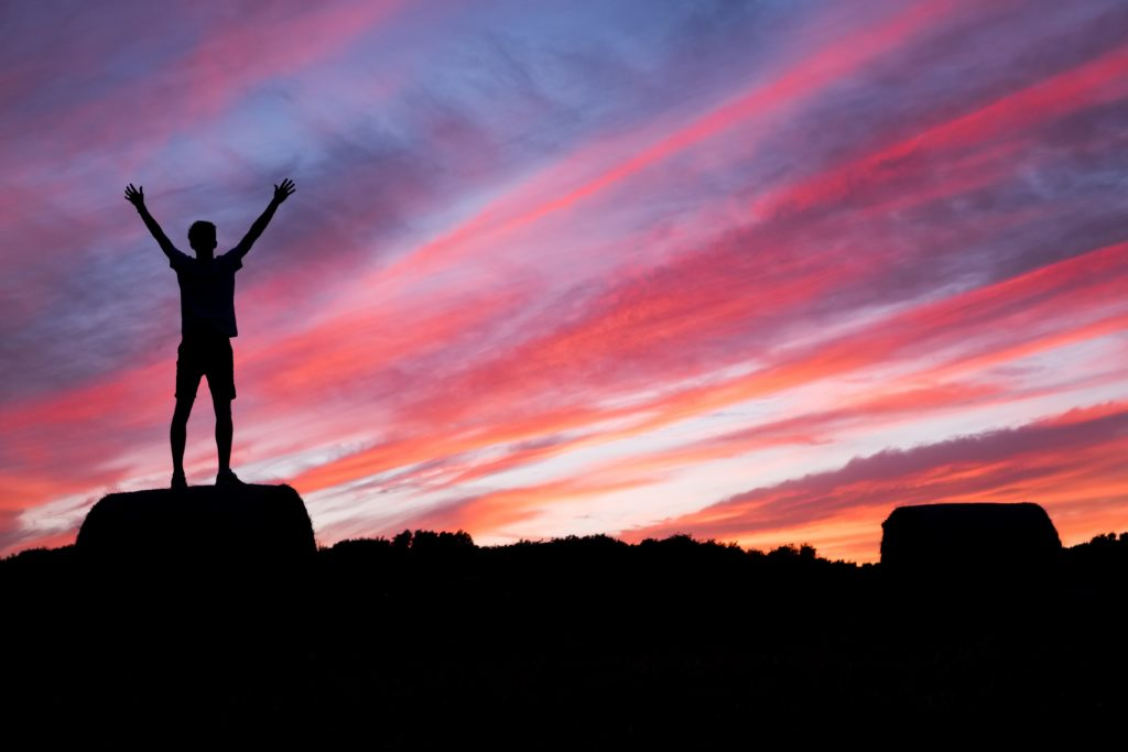 Silhouette of Man Raising Arms at Sunrise:Sunset