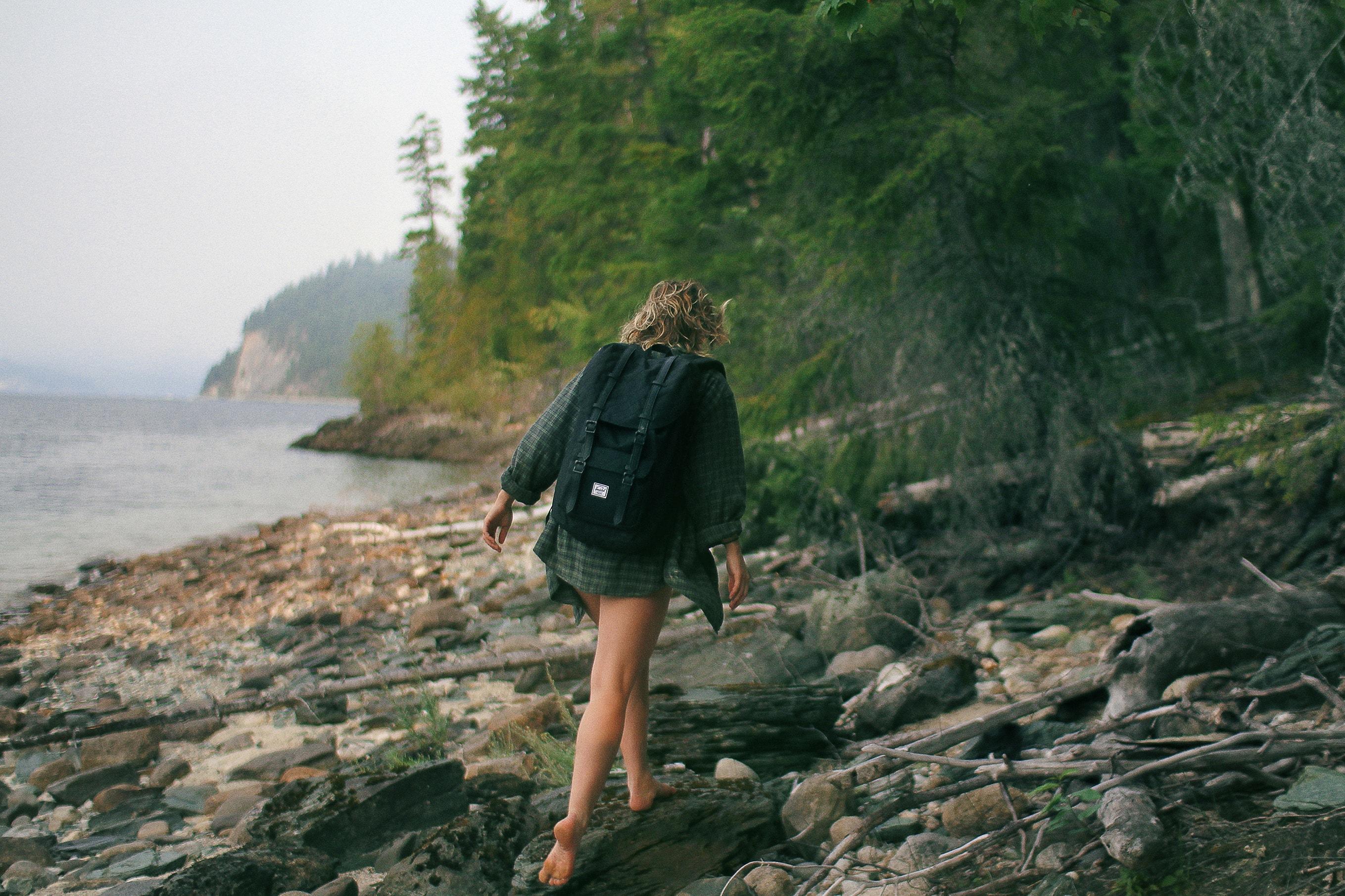 Woman Walking on Rocks