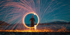 Circle of Sparks Around a Man