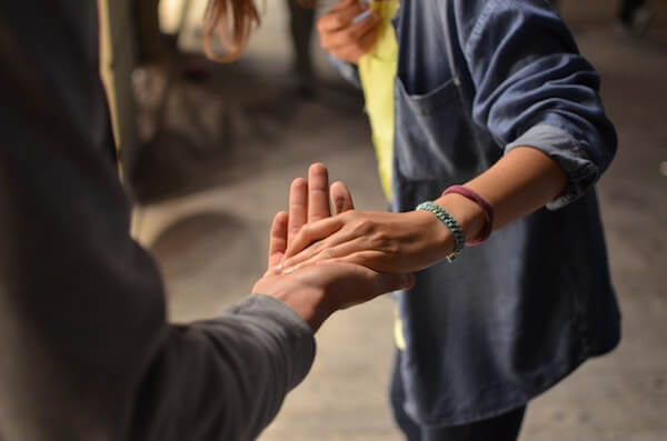 Trust in the workplace requires true vulnerability, the same level of vulnerability necessary to put your hand in someone else's, even for a handshake, as in this picture.