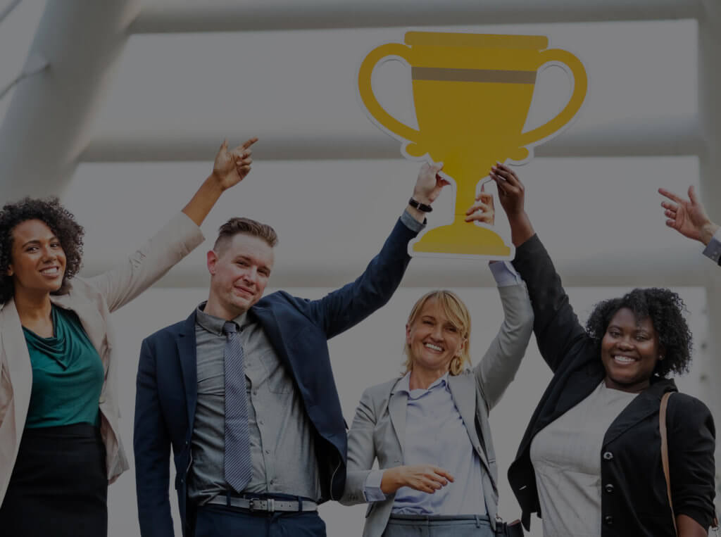 A solid performance management process leads to improved results and happier employees, just like the employees pictured here celebrating a win.